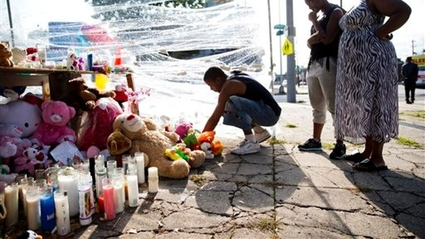 Makeshift memorial for three children who were killed by a hijacked car that lost control Friday in Philadelphia.