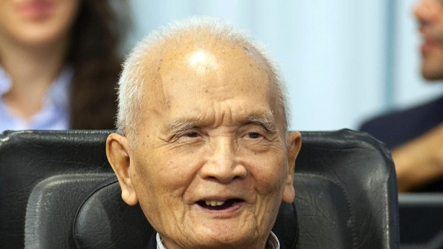 FILE - In this Oct. 31, 2013 photo released by the Extraordinary Chambers in the Courts of Cambodia, Nuon Chea smiles before his final statements at the U.N.-backed war crimes tribunal in Phnom Penh, Cambodia. The slow course of justice for the leaders of Cambodia's murderous Khmer Rouge regime will inch forward again Wednesday, July 30, 2014 as the tribunal holds an initial hearing against a pair of defendants in their 80s facing genocide and other charges. Khmer Rouge head of state, Khieu Samphan, and Nuon Chea, right-hand man to the group's late chief, Pol Pot, are among the few surviving top leaders of the brutal communist group, which was responsible for an estimated 1.7 million deaths from starvation, exhaustion, disease and execution when it was in power in 1975-79. (AP Photo/Extraordinary Chambers in the Courts of Cambodia, Mark Peters)