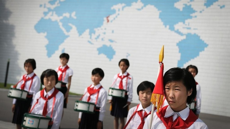 North Korean school girls stand in formation during an opening ceremony for the start of summer activities at the Songdowon International Children's Camp, Tuesday, July 29, 2014, in Wonsan, North Korea. The camp, which has been operating for nearly 30 years, was originally intended mainly to deepen relations with friendly countries in the Communist or non-aligned world. But officials say they are willing to accept youth from anywhere - even the United States. (AP Photo/Wong Maye-E)