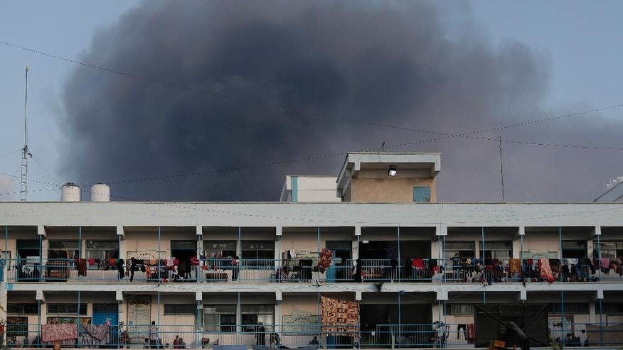 Smoke from the explosion of an Israeli strike rises over a U.N. school at Jebaliya refugee camp, in the northern Gaza Strip, where  Palestinian displaced people had found refuge, on Tuesday, July 29, 2014. The school is one of dozens of emergency shelters for those who have fled the fighting. About 180,000 Palestinians_about 10 percent of the entire population of Gaza_are seeking shelter in over 80 UNRWA schools, according to United Nations' Office for the Coordination of Humanitarian Affairs' July 28 report. (AP Photo/Lefteris Pitarakis)