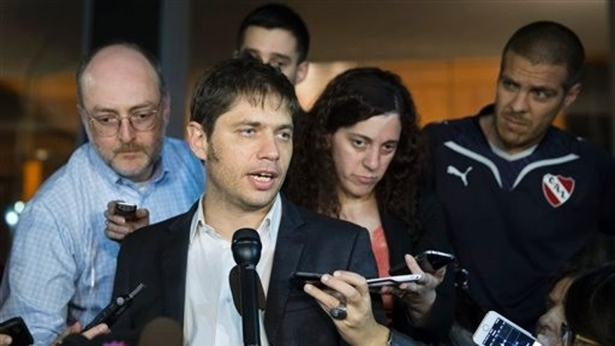Argentina's economy minister, Axel Kicillof, speaks to the media on Tuesday, July 29, 2014, in New York.