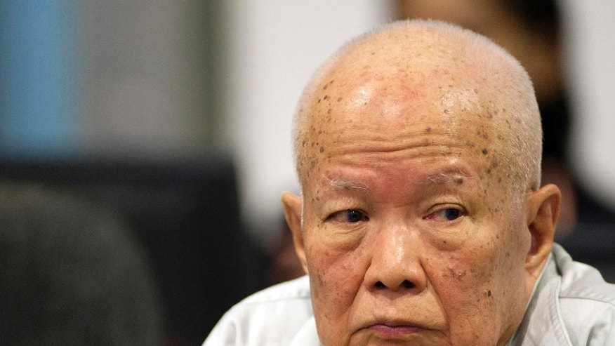 In this photo released by the Extraordinary Chambers in the Courts of Cambodia, Khieu Samphan, former Khmer Rouge head of state, sits in the court room during a hearing at a U.N.-backed war crimes tribunal in Phnom Penh, Cambodia, Wednesday, July 30, 2014. The U.N.-backed tribunal on Wednesday began a hearing to prepare for the genocide trial of the two senior surviving leaders of Cambodia's Khmer Rouge, under whose rule an estimated 1.7 million people died in the late 1970s from starvation, exhaustion, disease and execution. (AP Photo/Extraordinary Chambers in the Courts of Cambodia, Mark Peters)