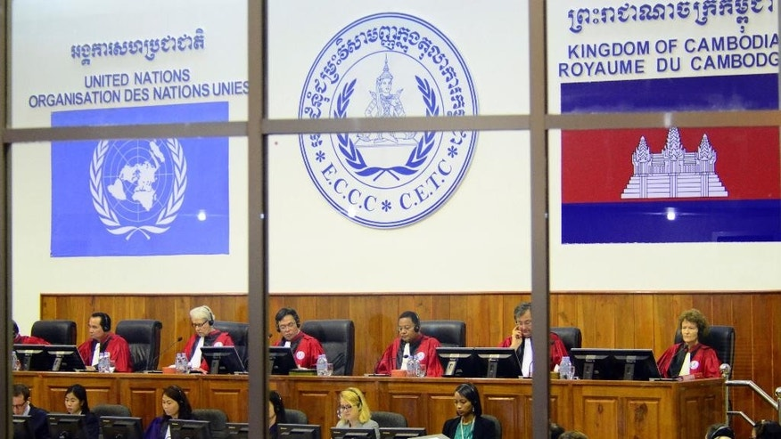 In this photo released by the Extraordinary Chambers in the Courts of Cambodia, a hearing is held at a U.N.-backed war crimes tribunal in Phnom Penh, Cambodia, Wednesday, July 30, 2014. The U.N.-backed tribunal on Wednesday began a hearing to prepare for the genocide trial of the two senior surviving leaders of Cambodia's Khmer Rouge, under whose rule an estimated 1.7 million people died in the late 1970s from starvation, exhaustion, disease and execution. (AP Photo/Extraordinary Chambers in the Courts of Cambodia, Nhet Sok Heng)