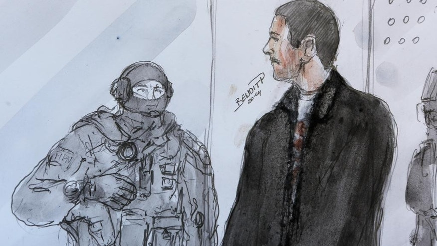 File - In this Thursday, June 12, 2014 file of an artists sketch, depicting Mehdi Nemmouche, right, as he stands next to a police agent during his court appearance at Versailles Court of Appeal.  On Tuesday, July 29, 2014, France extradited Nemmouche suspected in the shooting dead of four people at the Jewish Museum in Brussels, to Belgium. (AP Photo/Benoit P., File)