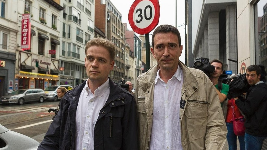 Sebastien Courtoy, right, and Henri Laquay, the two lawyers of suspect Mehdi Nemmouche, walk in front of the press at the headquarters of the federal police in Brussels on Tuesday, July 29, 2014. France on Tuesday extradited Mehdi Nemmouche, 29, who is suspected of shooting dead four people at the Jewish Museum in Brussels. (AP Photo/Thierry Monasse)