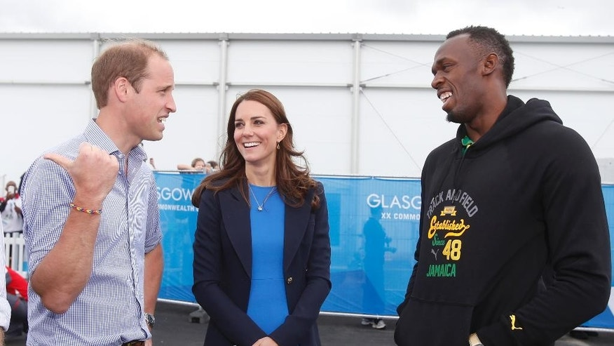 Britain's Prince William, left, and Kate, Duchess of Cambridge meet with Usain Bolt, right, during a visit to the Commonwealth Games Village in Glasgow, Scotland, Tuesday, July 29, 2014. (AP Photo/Danny Lawson, pool)