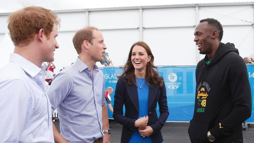 Britain's Prince Harry, left, Prince Willaim, second left, and Kate, Duchess of Cambridge, second right, meet with Usain Bolt during a visit to the Commonwealth Games Village in Glasgow, Scotland, Tuesday, July 29, 2014. (AP Photo/Danny Lawson, pool)