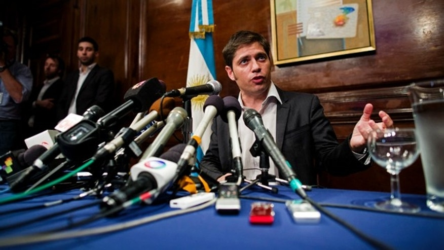 July 30, 2014: Axel Kicillof, Argentina's economy minister, addresses members of the news media after a negotiation session in New York. (AP Photo/Craig Ruttle)