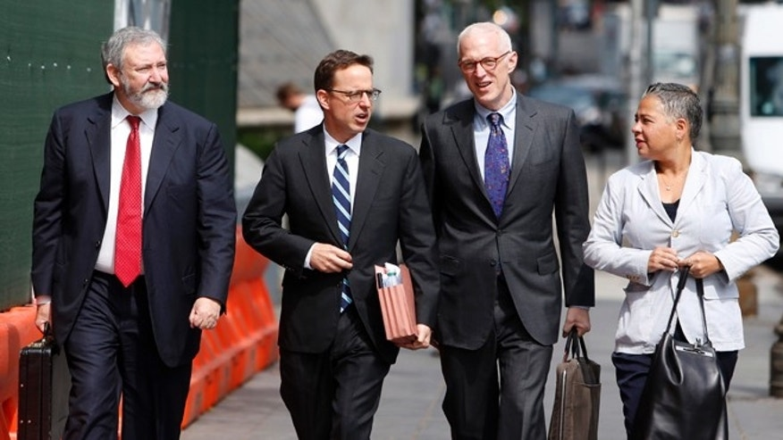 Lawyers for Argentina arrive at federal court on Friday, June 27, 2014, in New York.