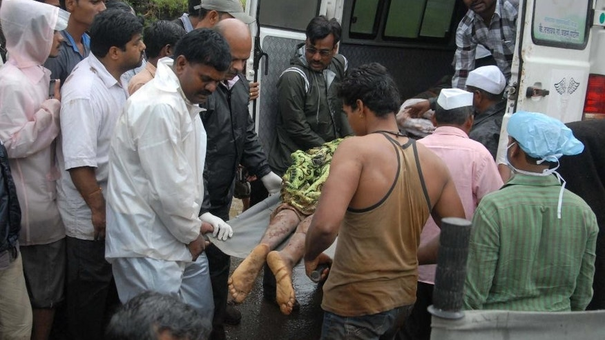 July 30, 2014: The body of a landslide victim is unloaded from an ambulance outside a hospital in Ghodegaon village, some 22 miles from Malin village, in the western Indian state of Maharashtra.