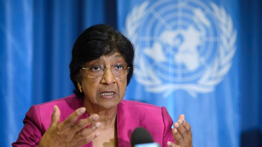 July 31, 2014: UN High Commissioner for Human Rights, South African Navi Pillay, answers journalist's questions about the human rights situation in the world, during a press conference at the Geneva Press Club, in Geneva, Switzerland.