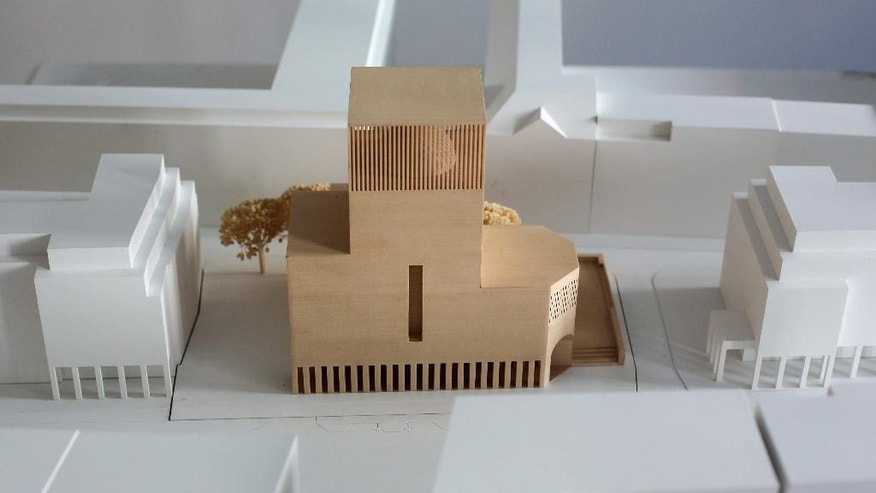 In this Friday, July 4, 2014 photo, a model of the prayer and educational building House of One is displayed at the office of the House of One association in Berlin. The House of One will house a Jewish synagogue, a Christian  church and a mosque. (AP Photo/Markus Schreiber)