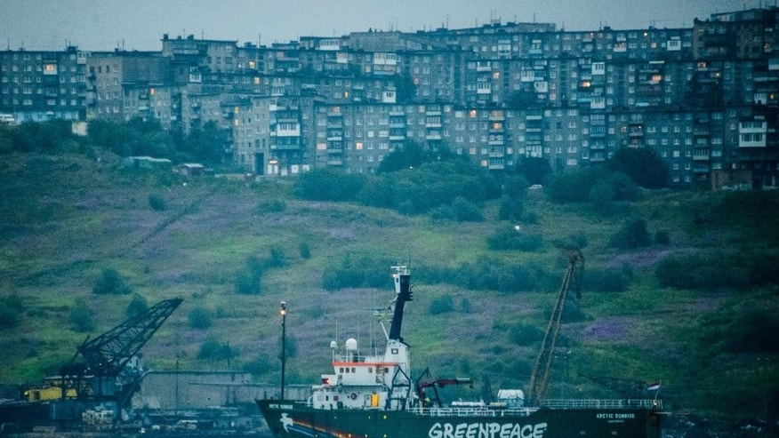 In this photo made available by Greenpeace International on Friday, Aug. 1, 2014, the Greenpeace ship Arctic Sunrise departs from Murmansk, Russia after it was held in the port by Russian authorities for eleven months. (AP Photo/ Vladimir  Baryshev, Greenpeace International)