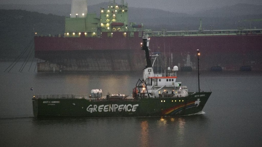 In this photo made available by the Greenpeace International on Friday, Aug. 1, 2014, the Greenpeace ship Arctic Sunrise departs from Murmansk, Russia after it was held in the port by Russian authorities for eleven months. (AP Photo/ Dmitri Sharonov, Greenpeace International)