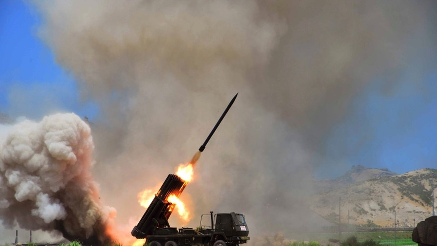 Undated - A view of a multiple rocket launcher during an exercise in this photo released by North Korea's Korean Central News Agency (KCNA) in Pyongyang.