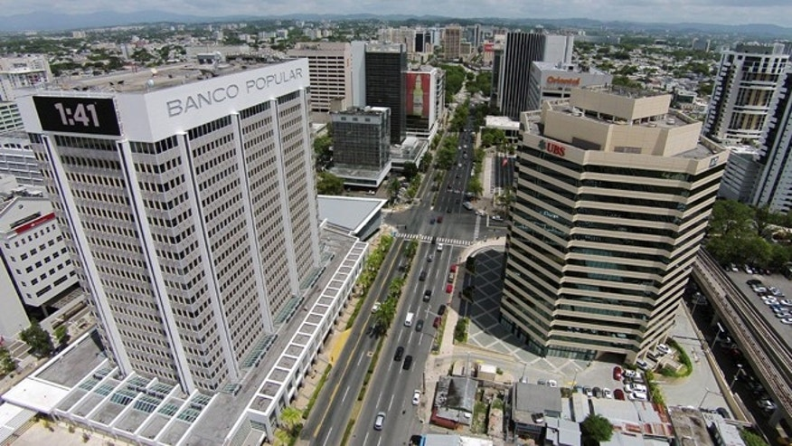 This July 16, 2014, phoro shows an aerial view of the financial district in San Juan, Puerto Rico. The territorys government has managed to buy some time to stave off an economic crisis, but it may only be for a moment. Creditors are closely watching whether the government tries to reach substantial agreements with banks this month on how to handle upcoming payments. (AP Photo/Ricardo Arduengo)