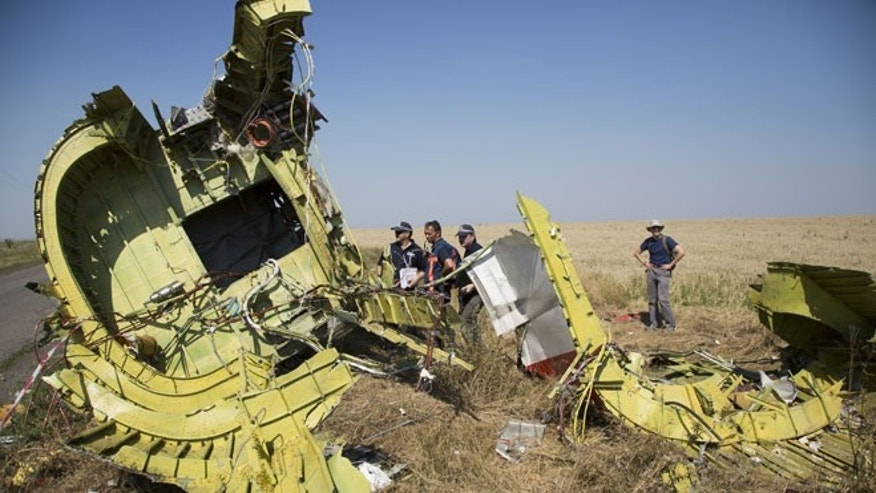 Aug 1, 2014: Australian and Dutch investigators examine pieces of the Malaysia Airlines Flight 17 plane, near  the village of Hrabove, Donetsk region, eastern Ukraine.