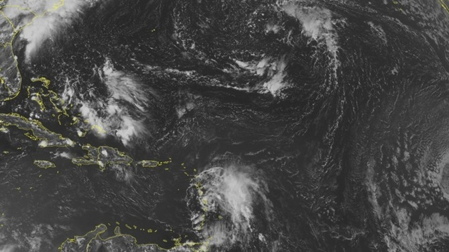 This NOAA satellite image taken Friday, Aug. 1, 2014, at 1:45 p.m. EDT shows a mass of clouds associated with Tropical Storm Bertha near the Lesser Antilles with most of the clouds and rain displayed to the east of the storm center. Clouds are prevalent over the Bahamas with some scattered rain and thunderstorms. Scattered storms are occurring over isolated portions of Hispaniola and Cuba.  (AP Photo/Weather Underground)