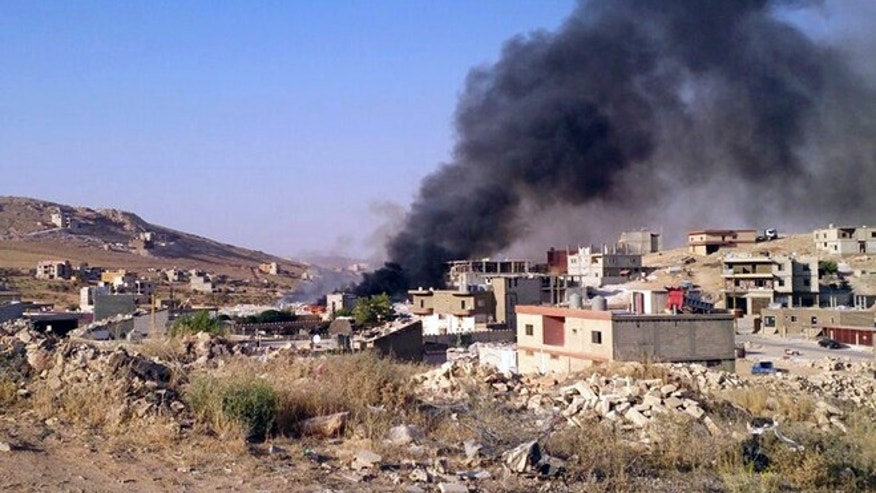 Aug. 2, 2014: Smoke billows from Arsal, a Sunni Muslim town near the Syrian border in eastern Lebanon. (AP)