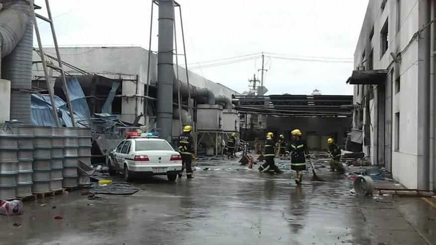 This photo released by China's Xinhua News Agency shows the site of an explosion at an eastern Chinese automotive parts factory in Kunshan City, Jiangsu Province Saturday, Aug. 2, 2014.  Dozens of people were killed Saturday by the explosion at the factory that supplies General Motors, state media reported. (AP Photo/Xinhua, Wang Hengzhi) NO SALES