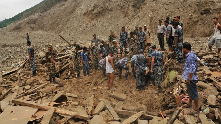 Nepalese soldiers search for bodies of victims beneath the debris after a massive landslide in village Mankha, about 120 kilometers (75 miles) east of Katmandu, Nepal, Sunday, Aug.3, 2014. Nepalese officials say there is no chance of finding any of the more than 150 people, who are believed to have been buried by the early Saturday landslide in northern Nepal. (AP Photo/Arpan Shrestha)
