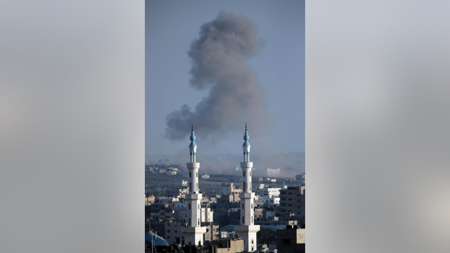 Smoke rises from an Israeli strike over Gaza City in the northern Gaza Strip on Sunday, Aug. 3, 2014. (AP Photo/Lefteris Pitarakis)