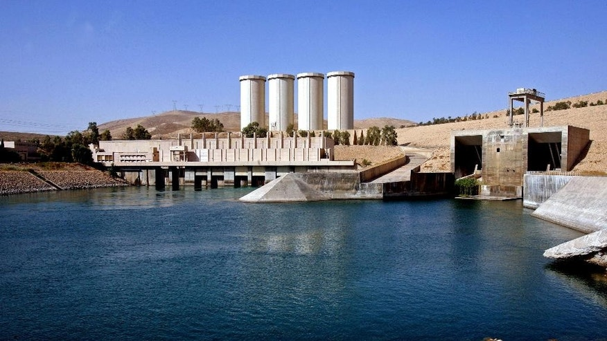 FILE - This Oct. 31, 2007 file photo, shows a general view of the dam in Mosul, 360 kilometers (225 miles) northwest of Baghdad, Iraq. The rapid advance of the Islamic State group, which captured Iraq's second largest city of Mosul and declared a self-styled Islamic Caliphate straddling the Iraq-Syria border, has plunged Iraq into its worst crisis since U.S. troops withdrew in 2011. Experts say the strategy for capturing the dams is twofold. First, seizing dams and large reservoirs can be used as a military tactic. Flooding the terrain slows any possible encounters with military tanks and foot soldiers, giving the militants freedom of movement, if briefly. (AP Photo/ Khalid Mohammed, File)