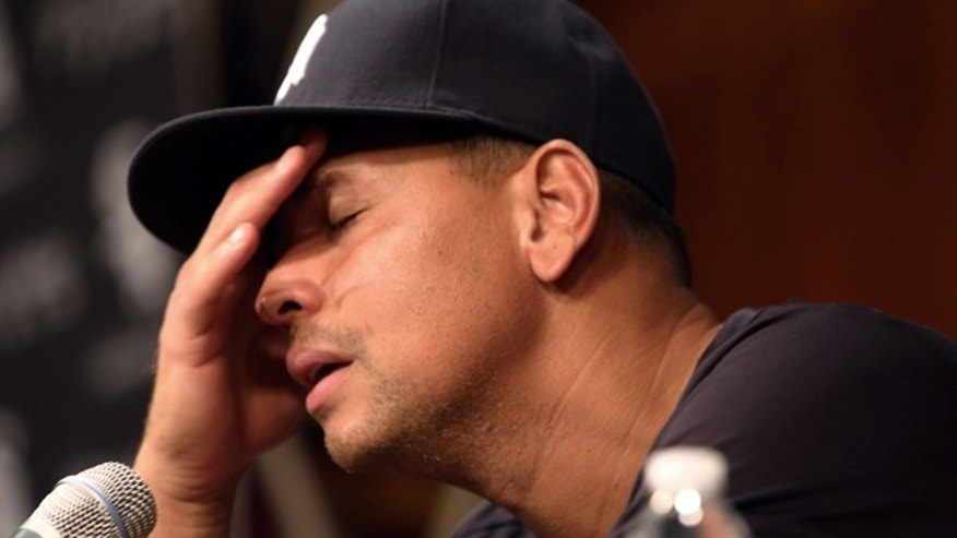 Aug. 5, 2013: New York Yankees Alex Rodriguez, with his hand to his head, talks during a news conference before the Yankees played the Chicago White Sox in a baseball game at US Cellular Field in Chicago. (AP/Charles Cherney, File)