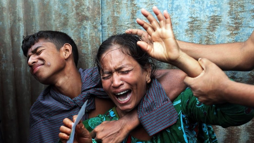 Bangladeshi woman Munni, whose daughters are missing, cries as rescuers search the River Padma after a passenger ferry capsized in Munshiganj district, Bangladesh, Monday, Aug. 4, 2014. A passenger ferry carrying hundreds of people capsized Monday in central Bangladesh, and at least 44 people either swam to safety or were rescued, but the number of missing passengers is not yet known. (AP Photo/ A.M. Ahad)