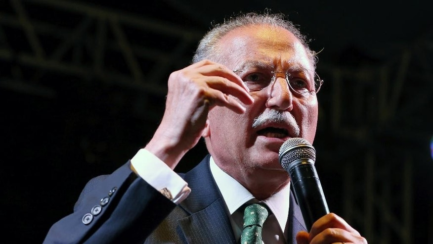 "Presidential candidate for upcoming Aug. 10, 2014 election, Professor Ekmeleddin Ihsanoglu, the former head of the Organization of Islamic Cooperation, addresses a rally in Ankara, Turkey, late Monday, Aug. 4, 2014. Ihsanoglu, who is supported by nearly all opposition parties, has highlighted creditentials as a champion of the Palestinians' cause, national unity as ""a president for all Turkish citizens"" and stability during his campaign for the presidential elections pitting him against Prime Minister Recep Tayyip Erdogan. (AP Photo/Burhan Ozbilici)"