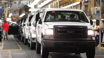 DEARBORN, MI - JUNE 13: New 2014 Ford F-150 trucks are prepared to come off the assembly line at the Ford Dearborn Truck Plant June 13, 2014 in Dearborn, Michigan. Production for the 2015 model F-150 at the plant is expected to begin in the 4th quarter of this year. (Photo by Bill Pugliano/Getty Images)
