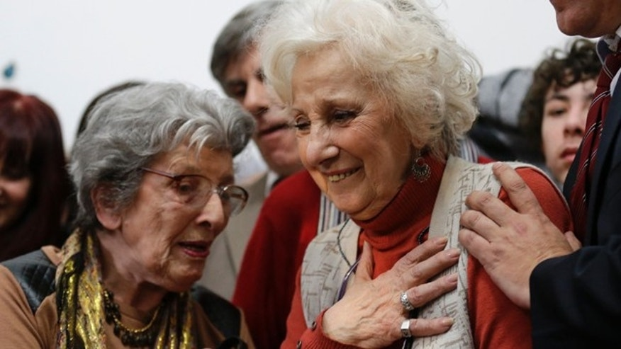 August 5, 2014: Estela de Carlotto, president of Grandmothers of Plaza de Mayo, right, reacts before a news conference in Buenos Aires, Argentina. Carlotto, one of the most prominent human rights activists in Argentina, has located the grandson born to her daughter Laura in captivity during the military dictatorship that ruled Argentina from 1976-1983. Laura was kidnapped and killed by the military in August 1978. (AP Photo/Victor R. Caivano)