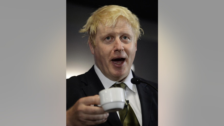 The Mayor of London Boris Johnson raises a cup during a speech and question and answer session in London Wednesday Aug. 6, 2014, where he declared his intention to stand for Parliament at next year's general election, finally putting an end to months of speculation about his ambitions for a return to the Houses of Parliament.  (AP PhotoStefan Rousseau/PA) UNITED KINGDOM OUT