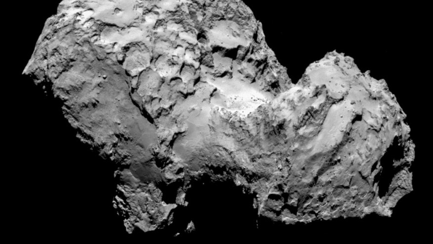 In this picture taken on Aug. 3, 2014 by Rosetta's OSIRIS narrow-angle camera Comet 67P/Churyumov-Gerasimenko is pictured from a distance of 285 kms. A mission to land the first space probe on a comet reaches a major milestone when the unmanned Rosetta spacecraft finally catches up with its quarry on Wednesday Aug 6, 2014. It's a hotly anticipated rendezvous: Rosetta flew into space more than a decade ago and had to perform a series of complex maneuvers to gain enough speed to chase down the comet on its orbit around the sun. The image resolution is 5.3 metres/pixel. (AP Photo/ESA/Rosetta/MPS for OSIRIS Team )