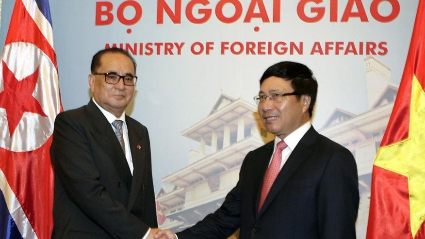 North Korean Foreign Minister Ri Su Yong, left, shakes hands with his Vietnamese counterpart Pham Binh Minh in Hanoi, Vietnam on Wednesday, Aug. 6, 2014. Ri is on a four-day visit to Vietnam as part of his Asia tour in a push to break its diplomatic isolation. (AP Photo/Tran Van Minh)