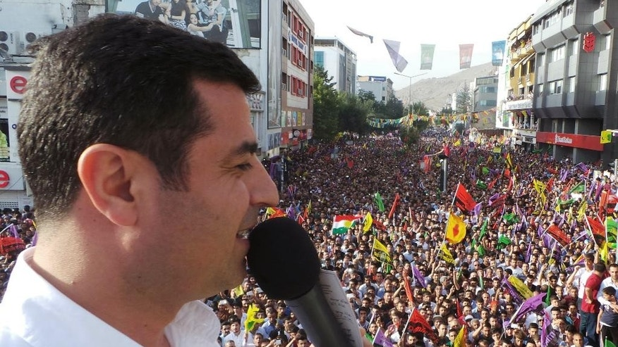 Turkish Kurdish presidential candidate for Aug. 10 election, Selahattin Demirtas, addresses his supporters in eastern Turkish city of Van, Turkey, Tuesday, Aug. 5, 2014.  Demirtas races against Prime Minister Recep Tayyip Erdogan and Professor Ekmeleddin Ihsanoglu, the former head of the Organization of Islamic Cooperation.(AP Photo/HDP Sosyal Medya)