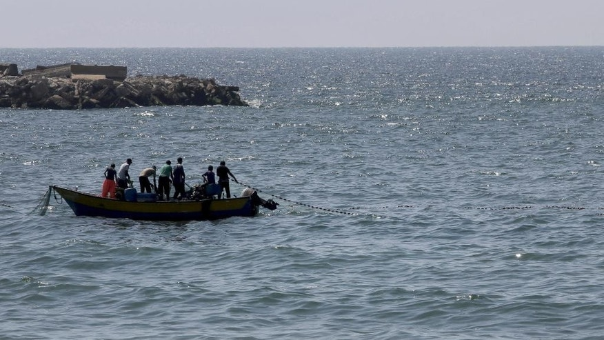 Aug. 7, 2014: Palestinian fishermen pull their fishnet at the Mediterranean Sea in Gaza City in the northern Gaza Strip. (AP)