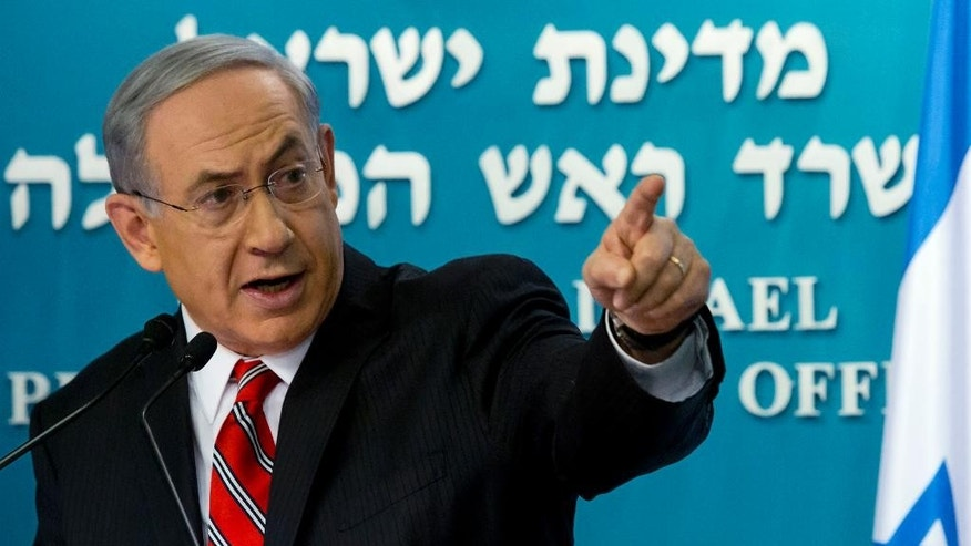 "Israeli Prime Minister Benjamin Netanyahu points at a video screen showing Hamas militants firing rockets into Israel from areas near schools and Hamas deploying civilians as human shields, as he gives a press conference in Jerusalem on Wednesday, Aug. 6, 2014. Netanyahu defended Israel's intense bombardment of Gaza, saying that despite the high civilian death toll it was a ""justified"" and ""proportionate"" response to Hamas attacks. (AP Photo/Jim Hollander, Pool)"