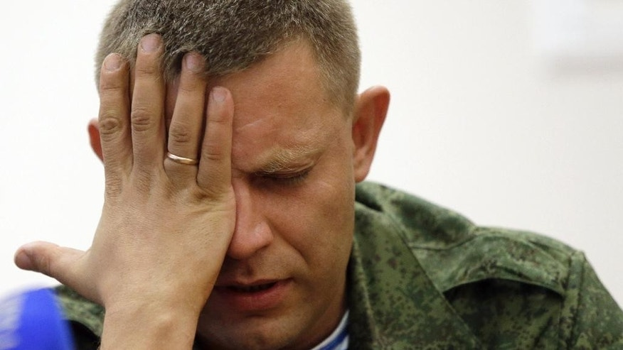 "Alexander Zakharchenko, who has been put forward as the new Prime Minister of the self-declared ""Donetsk People's Republic"", attends a press conference in Donetsk, eastern Ukraine,Thursday, Aug. 7, 2014. Outgoing prime minister Alexander Borodai announced he was resigning Thursday and that he would act as an adviser to Zakharchenko, once he has been confirmed by the separatist legislature. (AP Photo/Sergei Grits)"