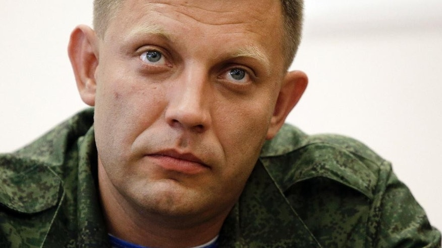 Alexander Zakharchenko, who has been put forward as the new prime minister of the self-declared Donetsk People's Republic, attends a press conference in Donetsk, eastern Ukraine,Thursday, Aug. 7, 2014. Outgoing prime minister Alexander Borodai announced he was resigning Thursday and that he would act as an adviser to Zakharchenko, once he has been confirmed by the separatist legislature. (AP Photo/Sergei Grits)