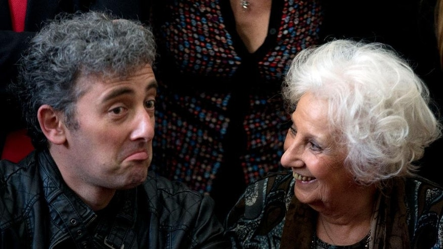 Estela de Carlotto, president of Grandmothers of Plaza de Mayo, right, and her grandson Ignacio Hurban attend a news conference in Buenos Aires, Argentina, Friday, Aug. 8, 2014. On Aug. 8, Carlotto located Hurban, the grandson born to her daughter Laura while in captivity during Argentina's military dictatorship. Laura was kidnapped and killed by the military in August 1978. Carlotto refers to him as Guido, the name her slain daughter intended to give him.(AP Photo/Natacha Pisarenko)