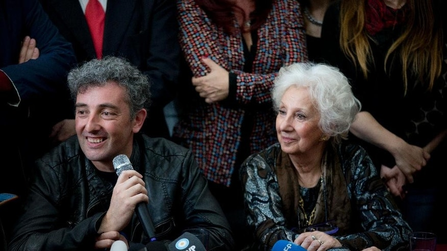 CORRECTS TO REMOVE WRONG DATE THAT HURBAN WAS IDENTIFIED - Estela de Carlotto, president of Grandmothers of Plaza de Mayo, right, and her grandson Ignacio Hurban, attend a news conference in Buenos Aires, Argentina, Friday, Aug. 8, 2014. A provincial music teacher in Argentina, Hurban is making his first public appearance since he was identified as the long-sought grandson of Carlotto, the country's leading human rights activist. She spent 36 years searching for the child taken from her daughter, who was executed by the military during the country's military dictatorship. Carlotto refers to him as Guido, the name her slain daughter intended to give him. (AP Photo/Natacha Pisarenko)