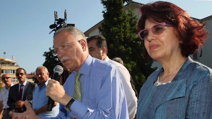 The main opposition candidate for Turkey's August 10 presidential election, Ekmeleddin Ihsanoglu, addresses a rally as his wife Fusun Ihsanoglu listens in Ordu, Turkey, Thursday, Aug. 7, 2014. Ihsanoglu is a mild-mannered scientist and academic who served as the secretary-general of the Organization of Islamic Cooperation from 2004-14. He is backed by about a dozen opposition parties, including the two main ones: the center-left Republican People's Party and the right-wing Nationalist Movement Party. Ihsanoglu, 70, has focused his campaign on unity and inclusiveness, promising to ensure the presidency would be for all Turks. (AP Photo/Volkan Yildirim)