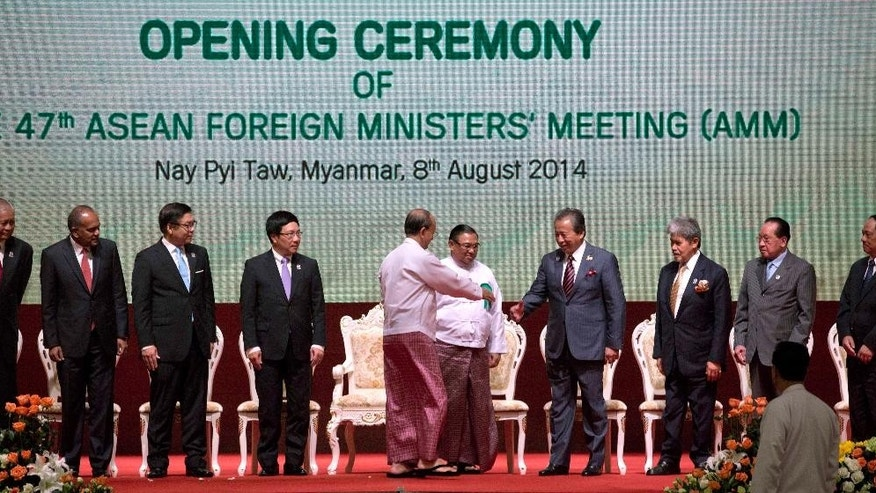 Myanmar's President Thein Sein, fifth from left greets foreign ministers of Association of Southeast Asian Nations (ASEAN) from left, Philippine Foreign Secretary Albert del Rosario, Singaporean Foreign Minister K. Shanmugam, Thai Foreign Ministry's Permanent Secretary Sihasak Phuangketkeow, Vietnamese Foreign Minister Pham Binh Minh, Myanmar Foreign Minister Wunna Maung Lwin, Malaysian Foreign Minister Anifah Aman, Brunei's Foreign Minister Prince Mohamed Bolkiah, Cambodian Foreign Minister Hor Namhong and ASEAN Secretary General Le Luong Minh of Vietnam, after posing for a group photo during the opening ceremony of 47th ASEAN Foreign Ministers meeting in Naypyitaw, Myanmar, Friday, Aug. 8, 2014.(AP Photo/Gemunu Amarasinghe)