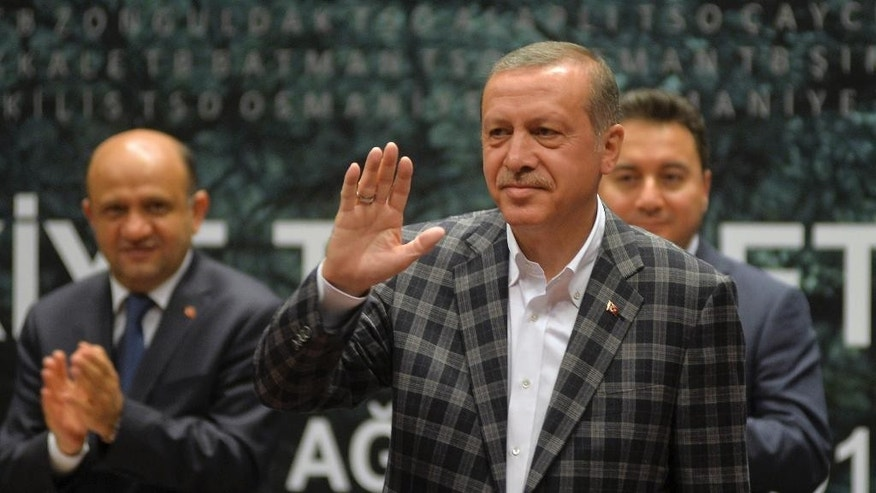 In this Thursday, Aug. 7, 2014 photo, Turkish Prime Minister and presidential candidate Recep Tayyip Erdogan salutes as addresses a business meeting in Ankara, Turkey. Turkey holds its first direct presidential elections on Sunday, Aug. 10, 2014, when voters will be tasked with choosing between three candidates for the post, which until now has been largely ceremonial. The 60-year-old Erdogan, who has dominated Turkish politics for the past decade, is widely expected to win, possibly even in the first round. A gifted public orator who grew up in a tough neighborhood of Istanbul, Erdogan leads the Islamic-rooted Justice and Development Party, or AKP, whose support base is the Turkish heartland. (AP Photo)