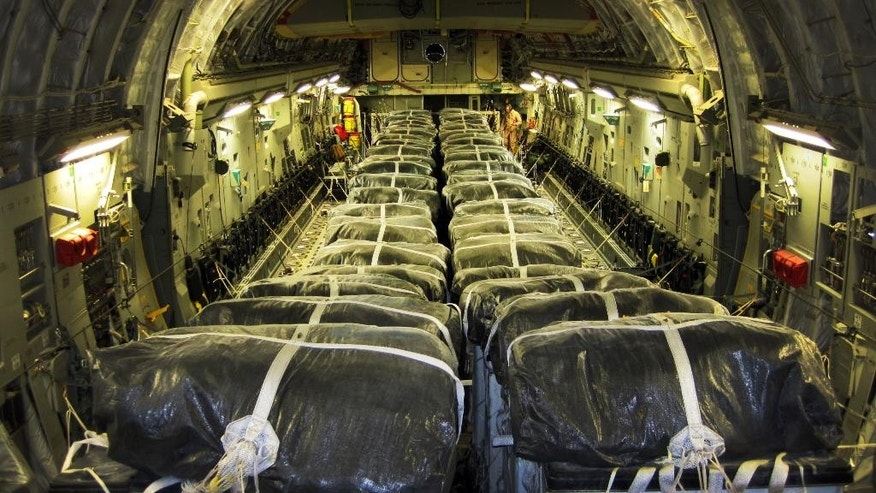 This image provided by the U.S. Defense Department shows pallets of bottled water are loaded aboard a U.S. Air Force C-17 Globemaster III aircraft in preparation for a humanitarian airdrop over Iraq Aug. 8, 2014. Airmen with the 816th Expeditionary Airlift Squadron airdropped 40 bundles of water for displaced citizens in the vicinity of Sinjar, Iraq. American planes conducted a second airdrop of food and water early Saturday for those trapped in the Sinjar mountains, said Pentagon chief spokesman Rear Adm. John Kirby. (AP Photo/U.S. Air Force, Staff Sgt. Vernon Young Jr.)