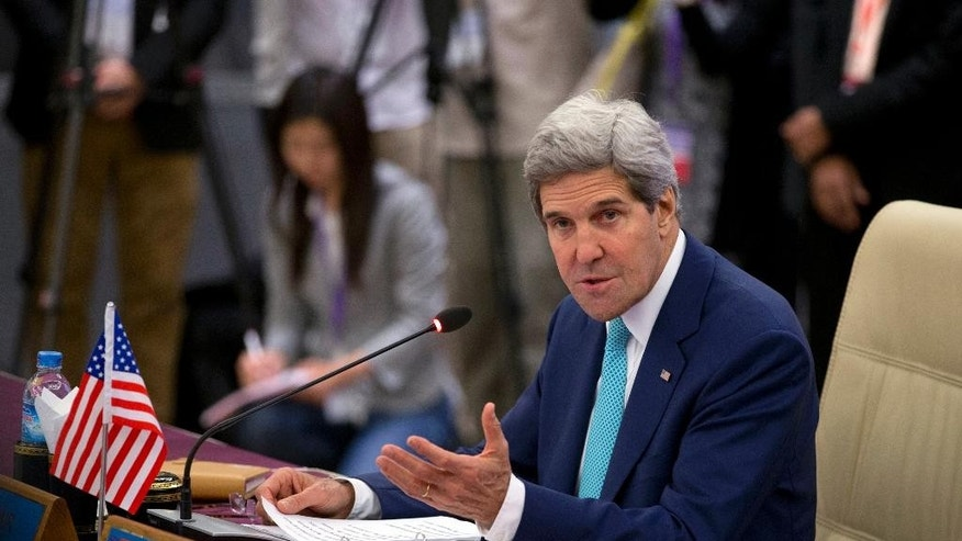 U.S. Secretary of State John Kerry address during the Association of Southeast Asian Nations (ASEAN) and U.S. Ministerial meeting in Naypyitaw, Myanmar, Saturday, Aug 9, 2014. (AP Photo/Gemunu Amarasinghe)