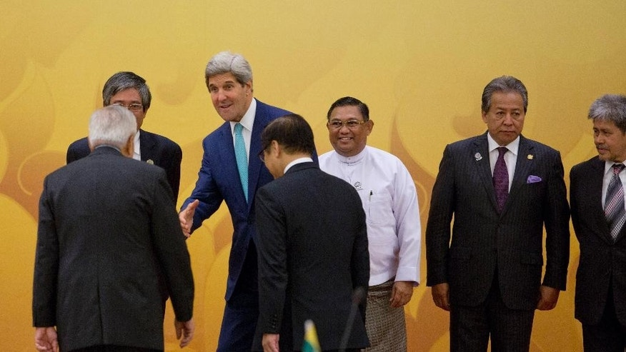 U.S. Secretary of State John Kerry, second left, reaches to shake hands with Philippines Foreign Minister Alberto Del Rosario as Myanmar Foreign Minister Wunna Maung Lwin, third from right, Malaysian Foreign Minister Anifah Aman, second right, and Brunei Foreign Minister Prince Mohamed Bolkiah, right watch upon Kerry's arrival for Ministerial meeting between the Association of Southeast Asian Nations (ASEAN) and U.S. in Naypyitaw, Myanmar, Saturday, Aug 9, 2014.(AP Photo/Gemunu Amarasinghe)