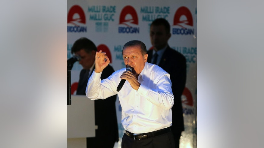 Turkish Prime Minister Recep Tayyip Erdogan addresses a rally in Ankara, Turkey, Friday, Aug. 8, 2014. Some 53 million Turks go the polls on Sunday to choose their 12th president in an election considered a turning point for the country of 76 million people, with Prime Minister Recep Tayyip Erdogan vying for the position he has pledged to transform from a symbolic role into a position of power. Ekmeleddin Ihsanoglu, the former chief of the Organization of Islamic Cooperation, and Kurdish politician Selahattin Demirtas are also running.(AP Photo/Burhan Ozbilici)