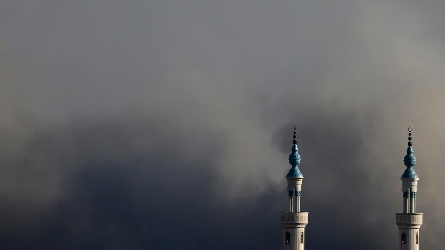Smoke rises over Gaza City after an Israeli strike on Friday, Aug. 8, 2014, as Israel and Gaza militants resumed cross-border attacks on Friday after a three-day truce expired and Egyptian-brokered talks on a new border deal for blockaded Gaza hit a deadlock. (AP Photo/Hatem Moussa)